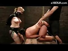 Girl With Tied Legs Getting Pussy And Mouth Fucked By The Master And Slave Girl With Strapon On The