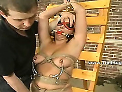 Slut bound incredibly tight with ropes in rough bdsm video getting spanked and clipped