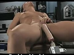 Brunette Rubs Her Clit with Vibrator While Getting Fucked By Machine