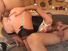 Curly brunette bitch abused by two hard cocks
