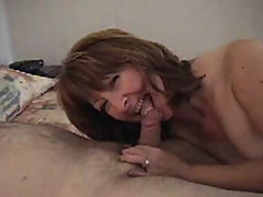 Mature couple tasting each other juices