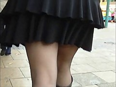 Black stockings boots and a mini skirt