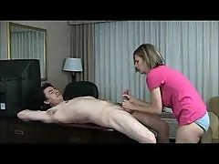 Horny wife gives handjob in hotel room
