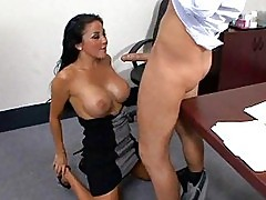 Sexy busty brunette gets down on knees to suck cock