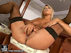 Busty Jasmine Rouge fingers her juicy twat in sexy black stockings