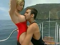 Lifeguard lady sucks and fucks a hard cock